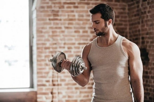 Man Doing Dumbbell Workout