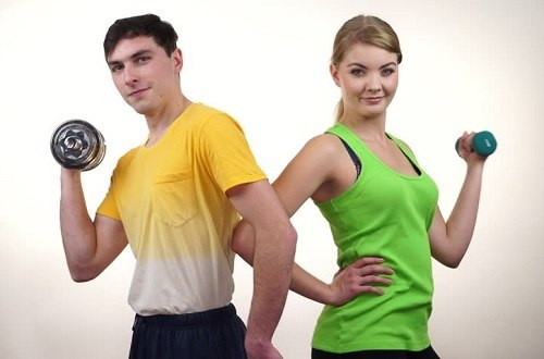 Man And Woman Holding Dumbbells
